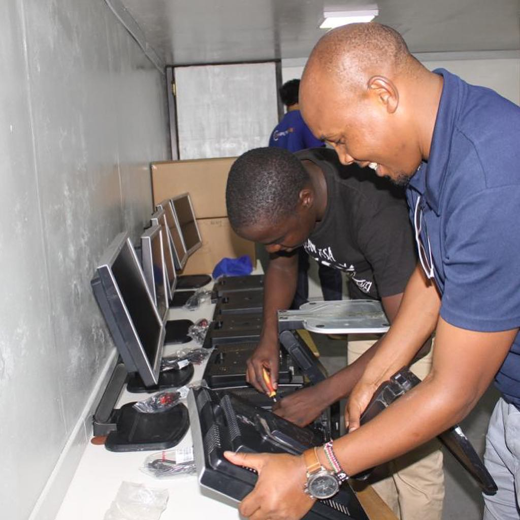 Volunteers from Orion GMS help to install a computer lab