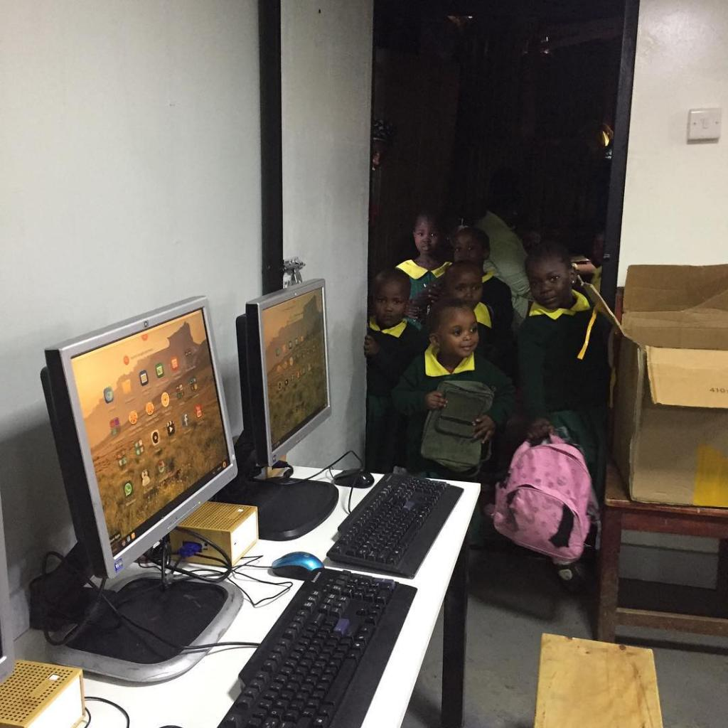 Children waiting to enter the new Malezi School Computer Lab